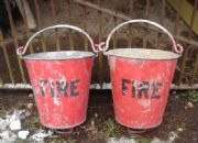 Lot 2513 A striking pair of vintage fire buckets £100-150